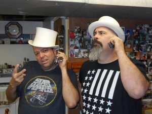 Chuck & Byron in hats and ghetto phones